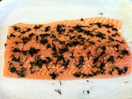 Rub dill into salmon
