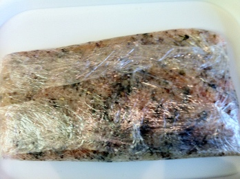Wrap the salmon in clingfilm